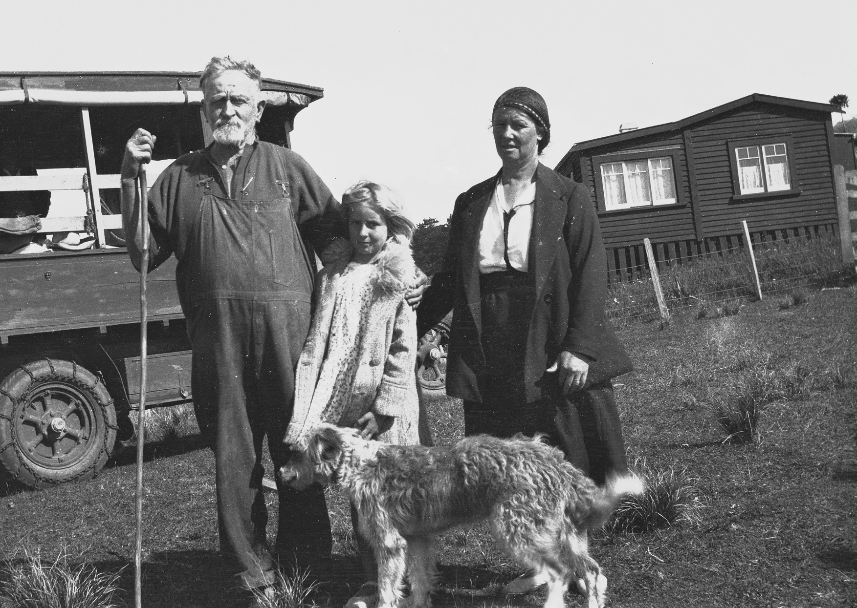 Pa Bethell, Lavinia Perry and Mrs Marie Perry with the dog, Anawhata Jack, on Anawhata Road, c1930, West Auckland Heritage